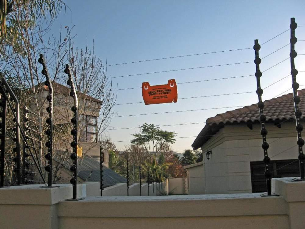 Wall Top Electric Fencing Installation And Repair Call